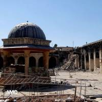 Aleppo's 12th-century Umayyad mosque, shown in April 2013, was damaged by shelling. | AP