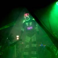 A person in an illuminated alien costume arrives Friday for a parade at the annual Alien Festival in Capilla del Monte, Argentina, the site of an alleged UFO sighting 30 years ago. | AP