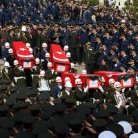 Soldiers carry the coffins of victims as Turkish Army commanders, ministers and family members attend funeral prayers for eight of the 28 victims of Wednesday's explosion in Ankara on Friday. | AP