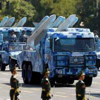 Vehicles carrying ship-to-air missiles pass Tiananmen Square during a parade marking the 70th anniversary of the end of World War II, in Beijing on Sept. 3. | REUTERS