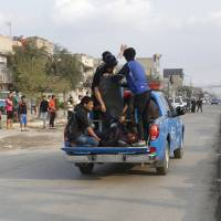 Iraqi security forces transport wounded after suicide blasts in Baghdad's Sadr City Sunday. The death toll from two suicide blasts in Baghdad's mainly Shiite district of Sadr City rose to 24 with more than 60 others wounded, police and medical sources said on Sunday. | REUTERS