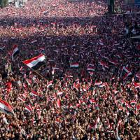 Supporters of prominent Iraqi Shiite cleric Moqtada al-Sadr shout slogans during a protest over corruption at Tahrir Square in Baghdad Friday. | REUTERS