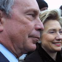 Then-New York Mayor Michael Bloomberg in seen in 2002 with then-Sen. Hillary Clinton as they attend the St. Patrick's Day parade in the Queens borough of New York. Bloomberg sees an opportunity emerging in presidential politics after Hillary Clinton's blowout defeat in New Hampshire combined with Donald Trump's ascension in the tumultuous Republican race. | AP