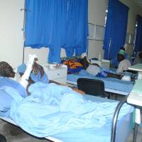 Victims of a Boko Haram attack in Dalori village receive treatment at a hospital in Maiduguri, Nigeria, Monday. A survivor hidden in a tree says he watched Boko Haram extremists firebomb huts and listened to the screams of children among people burned to death in the latest attack by Nigeria' s homegrown Islamic extremists. | AP