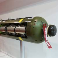 A Textron Systems CBU-105 sensor fused weapon sits on display at the Singapore Airshow on Wednesday. | BLOOMBERG