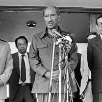 Egyptian President Anwar Sadat is flanked by Israeli Foreign Minister Yitzhak Shamir (left) and Egyptian Minister of State for Foreign Affairs Boutros Boutros-Ghali in Alexandria, Egypt. Sadat said 'It has been a happy occasion to meet with Minister Shamir, we had a very friendly and fruitful discussion.' | AP