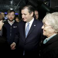U.S. Republican presidential candidate Sen. Ted Cruz greets supporters at a campaign event on the USS Yorktown in Mount Pleasant, South Carolina, Tuesday. | REUTERS