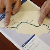 Dan Richard, chairman of the board that oversees the California High-Speed Rail Authority, shows a map of the proposed initial construction of the bullet train on Thursday in Sacramento. | AP