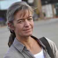 Swiss hostage Beatrice Stockly arrives in 2012 at Ouagadougou airbase. Private Mauritanian news agency Al-Akhbar said Wednesday that it had received a video purportedly from the al-Qaida-linked Emirate of the Sahara group claiming responsibility for this month's kidnapping of Stockly in northern Mali. | AFP-JIJI