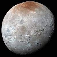 Giant fractures on Pluto's moon Charon, shown here in a photo taken by the New Horizons spacecraft last July 14, dwarf the Grand Canyon and are the largest known in the solar system. | NASA / JOHNS HOPKINS UNIVERSITY APPLIED PHYSICS LABORATORY / SOUTHWEST RESEARCH INSTITUTE