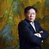 Chinese real estate mogul Ren Zhiqiang poses for a photo at his office in Beijing in 2012. Following its pledge to more tightly control media, Chinese authorities shut down microblogging accounts belonging to the real estate mogul and government critic after he lambasted state media organs for swearing fealty to the ruling Communist Party. | AP