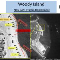 This image with notations provided by ImageSat International N.V., Wednesday shows satellite images of Woody Island, the largest of the Paracel Islands in the South China Sea. A U.S. official confirmed that China has placed a surface-to-air missile system on Woody Island but it is unclear whether this is a short-term deployment or something intended to be more long-lasting. | IMAGESAT INTERNATIONAL N.V. VIA AP