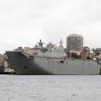 Australia's amphibious assault ships, the HMAS Canberra (left) and Adelaide, lie moored at Garden Island Naval base in Sydney on Nov. 3. | REUTERS