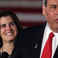Tears well up in Mary Pat Christie's eyes as her husband Republican presidential candidate and New Jersey Gov. Chris Christie addresses supporters during a primary night rally in Nashua, New Hampshire, on Tuesday. | AP
