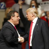 New Jersey Gov. Chris Christie greets Republican presidential candidate Donald Trump at a rally in Oklahoma City on Friday. | AP