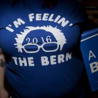 An attendee wears a T-shirt endorsing 2016 Democratic presidential candidate Bernie Sanders during a campaign event in Exeter, New Hampshire, on Friday. | BLOOMBERG