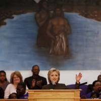 Democratic presidential candidate Hillary Clinton addresses the congregation about the Flint water crisis at the House of Prayer Missionary Baptist Church in Flint, Michigan, Sunday. | REUTERS