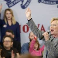 U.S. Democratic presidential candidate Hillary Clinton speaks during a campaign rally at Abraham Lincoln High School in Council Bluffs, Iowa, Sunday. | REUTERS