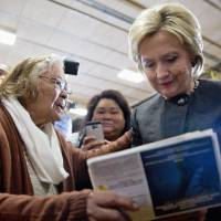 Democratic presidential hopeful Hillary Clinton signs an autograph for a supporter during a campaign event on Jan. 25 at the Knoxville School District Administration Office in Knoxville, Iowa. | AP