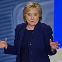Tones harden as Clinton girds for faceoff with rising star Sanders near his turf