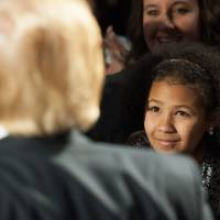 A young girl looks on as Republican Presidential candidate Donald Trump signs autographs for supporters at the conclusion of a Donald Trump rally at Millington Regional Jetport on Saturday in Millington, Tennesse. | AFP-JIJI