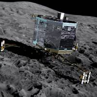 This file picture released by the European Space Agency on Dec. 20, 2013, shows an artist's impression of Rosetta's lander Philae (front view) on the surface of comet 67P/Churyumov-Gerasimenko. | AFP-JIJI
