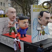 Security tight, weather iffy as topical Cologne carnival draws thousands