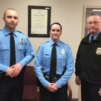 A photo provided by the Prince William County Police Department shows (from left) Officer Steven Kendall, Officer Ashley Guindon with Lt. Col. Barry Bernard, deputy chief of the Prince William County, Virginia, Police Department. Guindon was shot and killed Saturday and two of her colleagues were wounded in a confrontation stemming from a call about an argument. Guindon and Kendall were sworn in on Friday, and Guindon was working her first shift when she was killed. | PRINCE WILLIAM COUNTY POLICE DEPARTMENT VIA AP