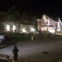Police remain on the scene late Saturday on Lashmere Court in Dale City, Virginia, where three Prince William County police officers were shot responding to a domestic violence call. Officer Ashley Guindon died in the shooting. | AP