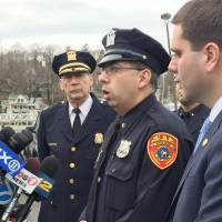 Suffolk County Police Officer Matthew Merced recounts how he and fellow officers helped rescue three men from a ditched aircraft during a news conference Sunday in Port Jefferson, New York. The single engine craft crashed into Port Jefferson Harbor on Saturday night. | AP