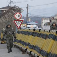South Korean soldiers walk Feb. 11 on Unification Bridge, which leads to the Demilitarized Zone, near the border village of Panmunjom in Paju, South Korea. The immense danger on the Korean Peninsula is that any military response from the South could quickly spiral into all-out war. | AP