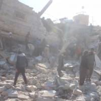 People gather Monday near a destroyed building reported to be a hospital supported by Medecins Sans Frontieres (Doctors Without Borders) in Marat al Numan, Idlib, Syria, in this still image taken from a video on a social media website. The French charity said at least eight staff were missing after an airstrike hit the hospital. | REUTERS