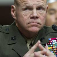 Marine Corps Commandant Gen. Robert Neller testifies on Capitol Hill in Washington Tuesday before the Senate Armed Services Committee hearing to examine the implementation of the decision to open all ground combat units to women. | AP
