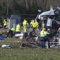 Emergency services look for evidence at the wreck of commuter train that derailed near Dalfsen, Netherlands, Tuesday. The train derailed after slamming into a crane that was crossing the tracks early Tuesday in the eastern Netherlands, killing one person and injuring six others, local emergency services said. | AP