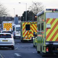 Nurse Pauline Cafferkey is driven by ambulance in a convoy after landing at Northolt just west of London, Feb. 23. A Scottish nurse, who recovered from Ebola but then suffered life-threatening complications from the virus persisting in her brain, was admitted to a hospital for a third time. She was discharged Sunday. | REUTERS