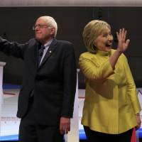 Democratic U.S. presidential candidates Sen. Bernie Sanders and former Secretary of State Hillary Clinton arrive on stage ahead of the start of a presidential candidates debate in Milwaukee on Thursday. | REUTERS