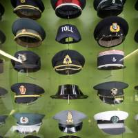 The hats of various European police border guards are displayed at the European Museum in Schengen, Luxembourg, on Feb. 4. | AP