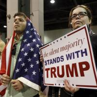 Supporters await the arrival of Republican U.S. presidential candidate Donald Trump at a rally in Atlanta on Sunday. | REUTERS