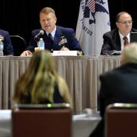 Capt. Jason Neubauer (center), chair of the marine investigation, questions Phil Morrell, vice president of operations for TOTE Maritime, at the hearings into the sinking of the El Faro ship, in Jacksonville, Florida, Tuesday. | BRUCE LIPSKY/THE FLORIDA TIMES-UNION VIA AP, POOL