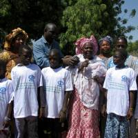This handout picture obtained from the child's rights organization Plan International on Wednesday shows anti-gemale genital mutilation activist Madina Bocoum Daff (center) speaking during an anti-FGM drive event in Koulountabali on March 6, 2014. | HANDOUT / PLAN INTERNATIONAL / AFP-JIJI