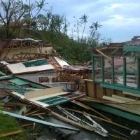 This handout photo taken and released by the Fiji Red Cross on Sunday shows damaged buildings at an undisclosed location on Fiji. | FIJI RED CROSS / AFP-JIJI