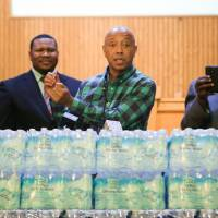 Def Jam co-founder Russell Simmons talks about the Flint water crisis Monday at Flint Trinity Missionary Baptist Church. | RYAN GARZA / DETROIT FREE PRESS VIA AP