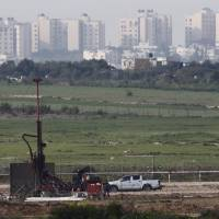 A drill can be seen at work on the line of the Israeli border with Gaza on Feb. 1. The Israeli government says its investigations have not come up with any evidence the night-time noises reported by villagers living near Gaza emanate from tunnels, but assertions by Hamas of extensive cross-border digging has only fueled concern. | REUTERS