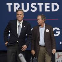 George W. Bush offers tough Trump takedown in campaign debut