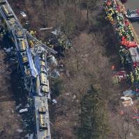 Rescue forces work at the site of a train accident near Bad Aibling, Germany on Tuesday. Several people were killed when two trains collided head-on. | AP