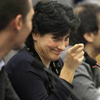 Massachusetts Institute of Technology astrophysics professor Nergis Mavalvala addresses an audience of scientists and journalists as MIT physics professor Matthew Evans (lef) and MIT research scientist Erik Katsavounidis look on during a presentation on the discovery of gravitational waves, Thursday in Cambridge, Massachusetts. | AP