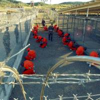 Obama hands unwilling Congress plan to close 'extremist recruitment tool' Guantanamo Bay prison
