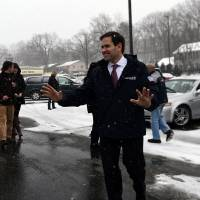 U.S. Republican presidential candidate Marco Rubio leaves after a campaign stop in Manchester, New Hampshire, on Monday. | AFP-JIJI
