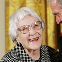 U.S. President George W. Bush speaks with novelist Harper Lee in the East Room of the White House in November 2007 before awarding her the Presidential Medal of Freedom. | REUTERS