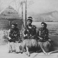 Native Hawaiian hula girls play the ukulele, popularized during the reign of King Kalakaua, in the 1890s. | HAWAII STATE ARCHIVES